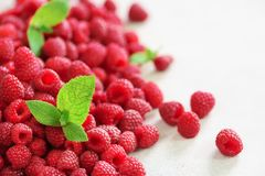 Fresh organic raspberries with mint leaves. Fruit background with copy space. Summer and berries harvest concept. Vegan. Vegetarian, raw food Stock Photo