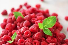 Fresh organic raspberries with mint leaves. Fruit background with copy space. Summer and berries harvest concept. Vegan. Vegetarian, raw food Stock Photography