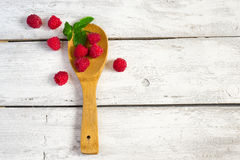 Fresh organic raspberries in a wooden spoon. Top view with copy Stock Images