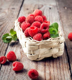 Fresh organic raspberry in basket. Selective focus Stock Photography