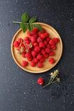 Fresh organic raspberry on plate Royalty Free Stock Photography