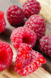 Fresh organic raspberry on rustic background Royalty Free Stock Photo
