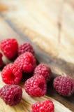 Fresh organic raspberry on wooden background Royalty Free Stock Image