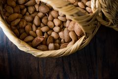 Fresh Organic Raw Almonds with Shell in Basket. Organic Food Royalty Free Stock Image