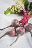 Fresh organic raw beets. Fresh organic farmer raw beets with leaves on a white marble kitchen table. copy space Royalty Free Stock Image