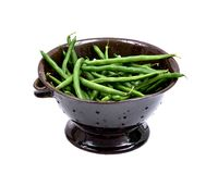 Fresh organic raw green beans in clay ceramic berry bowl, strainer. Isolated on white background Royalty Free Stock Photos