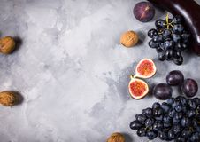 Fresh organic raw purple colored vegetables and fruits on stone background. Top view. Copyspace Royalty Free Stock Photography