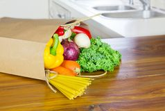 Fresh Organic Raw Vegetables food delivery in paper bag on wooden bench stock photos