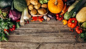 Fresh organic raw vegetables. On a wooden table,top view. Healthy food background wiht copyspace Stock Images