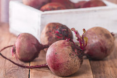 Fresh organic red beets. In a wooden box on rustic background Stock Image