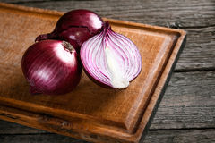 Fresh organic red onions. On a wooden background Stock Photography