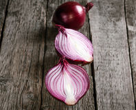 Fresh organic red onions. On a wooden background stock photo