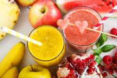 Fresh organic red and yellow smoothie Royalty Free Stock Photography