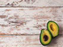 Fresh organic ripe avocado on old wooden table, top view, copy space Royalty Free Stock Photo