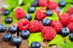 Fresh organic ripe raspberry and blueberry Stock Photos
