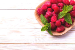 Fresh organic ripe raspberry with mint leaves in tray Stock Image