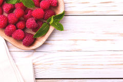 Fresh organic ripe raspberry with mint leaves in tray Royalty Free Stock Photography