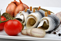 Fresh organic rollmops with tomato and onion. Some fresh organic rollmops with tomato and onion stock image