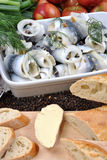 Fresh organic rollmops on a white plate. Some fresh organic rollmops on a white plate royalty free stock images