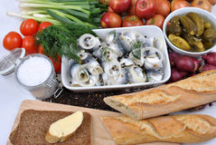 Fresh organic rollmops on a white plate. Some fresh organic rollmops on a white plate stock photos