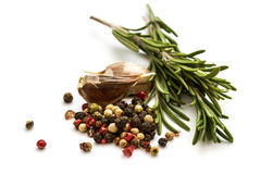 Fresh organic rosemary, pepper and garlic  on white Royalty Free Stock Image