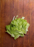 Fresh organic salad on wooden table Stock Photo