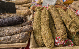 Fresh organic salami in basket on local market in France Royalty Free Stock Photos