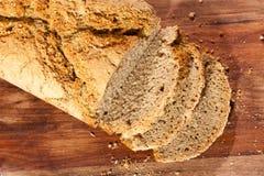 Fresh organic sliced bread. On a wooden desk Stock Photos