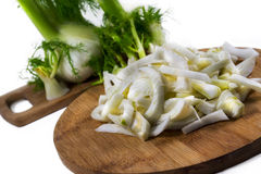 Fresh, organic slices of  fennel on a wooden board Stock Photo
