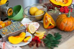 Fresh organic slices lemon and pumkin on table. Bio Healthy food Royalty Free Stock Photo