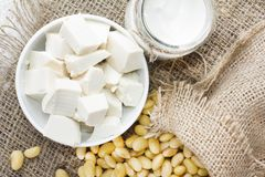 Fresh organic soy products:soy milk, soy yogurt, soy chese tofu. Healthy organic soy products: soy milk, soy yogurt, soy chese tofu and soy beans Royalty Free Stock Photos