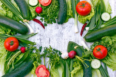 Fresh organic spring vegetables - healthy food. On white table Royalty Free Stock Image