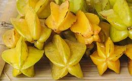 Fresh organic star apple fruit. Stock Photos