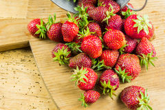 Fresh organic strawberries on a cutting board Stock Images