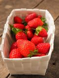 Fresh organic strawberries in a white basket Royalty Free Stock Photo