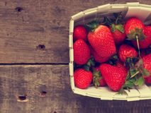 Fresh organic strawberries in a white basket Stock Photos
