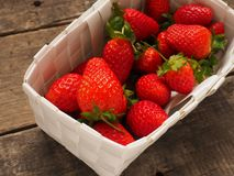 Fresh organic strawberries in a white basket Royalty Free Stock Images