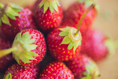 Fresh organic strawberry close-up on an old wooden background.  Royalty Free Stock Photo