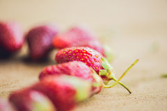Fresh organic strawberry close-up on an old wooden background.  Stock Photos