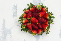 Fresh organic strawberry. On white stone plate. Space for text. Top view Stock Images