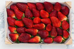 Fresh organic strawberry. In a wooden basket. Space for text. Top view Stock Photos