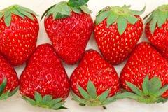 Fresh organic strawberry over white wood Royalty Free Stock Images