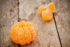 Fresh organic tangerines and peeled slices Royalty Free Stock Photo