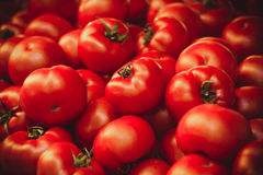 Fresh organic tomatoes at market background texture Stock Photo