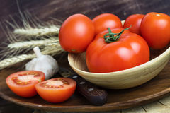 Fresh organic tomatoes on wooden table Royalty Free Stock Photo
