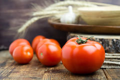 Fresh organic tomatoes on wooden table Stock Photo