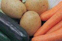 Fresh organic vegetable zucchini potatoes and carrots. Fresh organic vegetable zucchini potatoes and orange carrots Royalty Free Stock Images