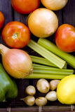 Fresh organic vegetables. A natural assortment of fresh organic vegetables and fruits on a wooden table Royalty Free Stock Photos
