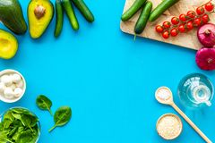 Fresh organic vegetables on blue background top view space for text. Kitchen desk for preparing salad frame stock image