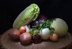 Fresh organic vegetables, cabbage, onions, potato, green onions, on a wooden background stock images